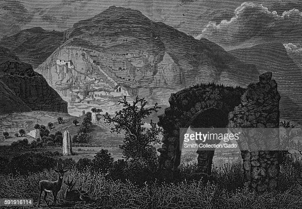 An etching that shows the landscape surrounding Mount Quarantania as seen from the ruins of the old city Jericho Israel 1882 From the New York Public...