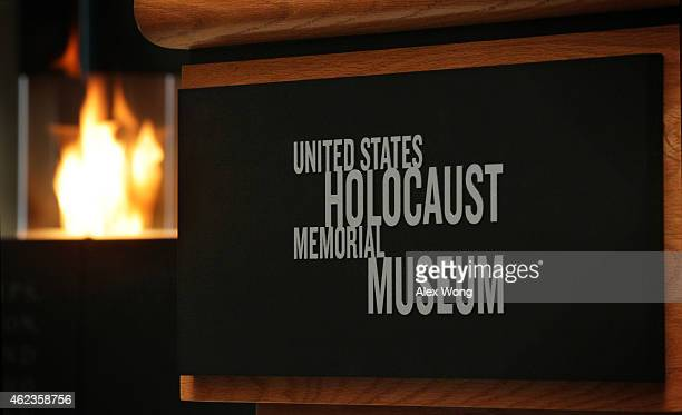 An eternal flame is lit in the Hall of Remembrance during an International Holocaust Remembrance Day event January 27 2015 at the US Holocaust...