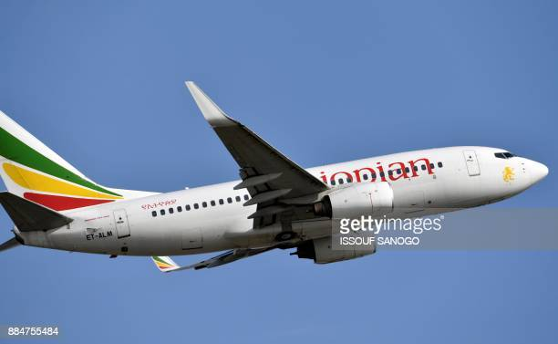 An Ethiopian Airline Boeing 737700 aircraft takes off from the Felix HouphouetBoigny Airport in Abidjan on November 28 2017 / AFP PHOTO / ISSOUF...