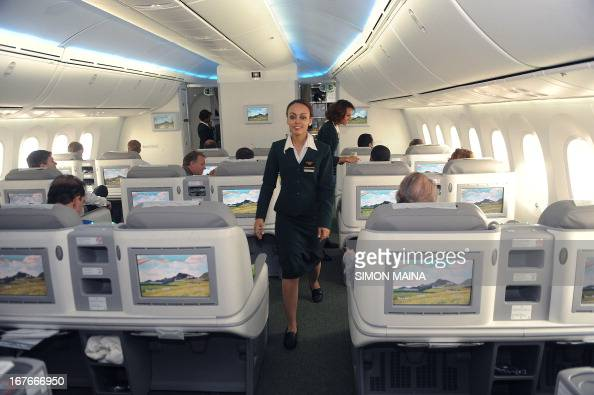 An Ethiopian Airlines Flight Attendant Walks Through The
