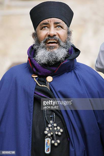 An Ethiopian Christian Orthodox priest attends the Washing of the Feet Easter ceremony in front of the Church of the Holy Sepulchre in Jerusalem's...