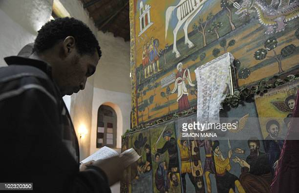 An Ethiopian faithful reads the bible before a mass at the St Raphael Coptic Orthodox in Entoto on the outskirts on May 27 2010 of the capital Addis...