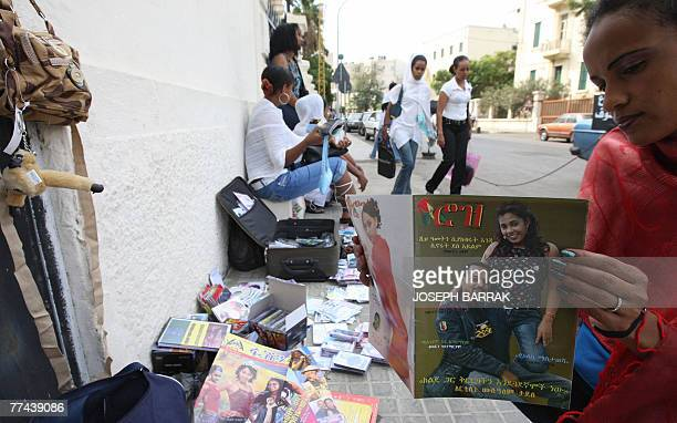 An Ethiopian house maid reads a magazine outside a church in Beirut 18 October 2007 Locked up and cut off from her family for nine years without even...