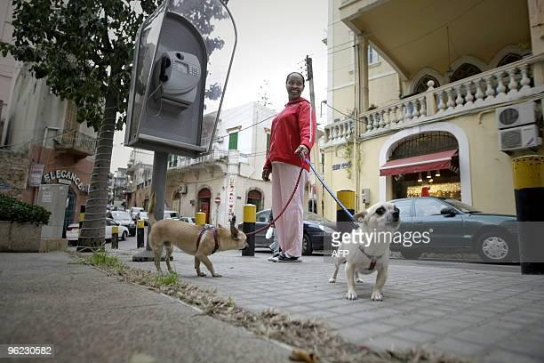 MOUSSAOUI An Ethiopian house maid walks her employers' dogs in Beirut's hip neighbourhood of Ashrafiyeh on January 12 2010 Lebanon's large domestic...