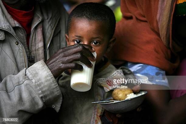 An Ethiopian Jewish boy gets a meal at the Jewish Joint Distribution Committee feeding center on May 1 2007 in Gondar in northern Ethiopia Some 2500...