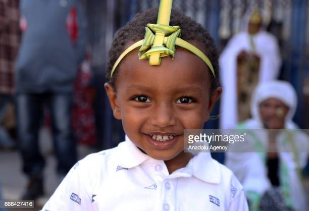 An Ethiopian kid arrives at St Urael Orthodox Church to attend the Hosanna Day celebrations ahead of the Easter in Addis Ababa Ethiopia on April 09...