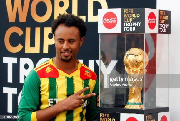 An Ethiopian man poses for a photo near the World Cup Trophy at Hilton Hotel after the trophy was brought to Ethiopia within the 2018 FIFA World Cup...
