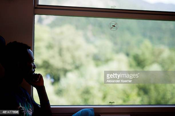 An Ethiopian migrant sits inside a train in an attempt to reach the Brenner Pass at the Austrian border on 21 July in Bolzano Italy Approximately 40...