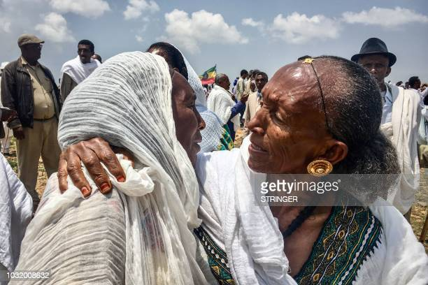 An Ethiopian mother meets with her daughter from Eritrea during the reopening border ceremony on September 11 2018 as two land border crossings...