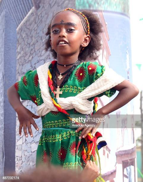 An Ethiopian Orthodox Christian girl dances during Ashenda Festival with her traditional outfits at Romanat Square in Mek'ele of the northern Tigray...