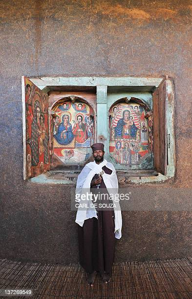 An Ethiopian Orthodox Christian monk poses while holding a cross at Ure Kidane Mihret monastery at Lake Tana in Bahar Dar Ethiopia on January 17 2012...