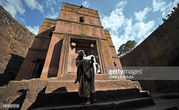 An Ethiopian Orthodox Christian pilgrim leaves the rockhewn church Bete Giyorgis after attending a mass before the annual festival of Timkat in...