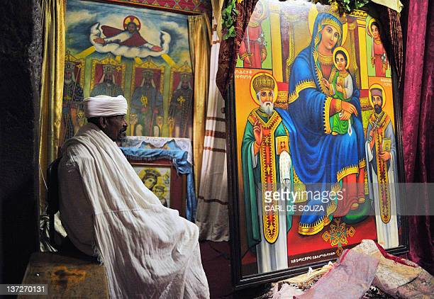 An Ethiopian Orthodox Christian priest sits inside a church in Lalibela on January 18 2012 Ethiopian monks and priests are preparing for the annual...