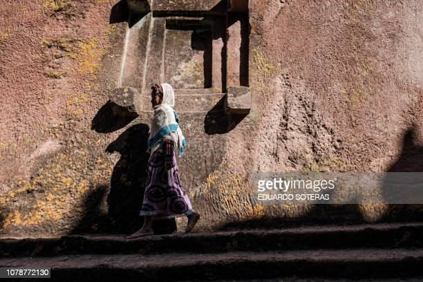 An Ethiopian Orthodox pilgrim girl walks during the Christmas Eve celebration at Saint George Church in Lalibela on January 06 2019 The Ethiopian...