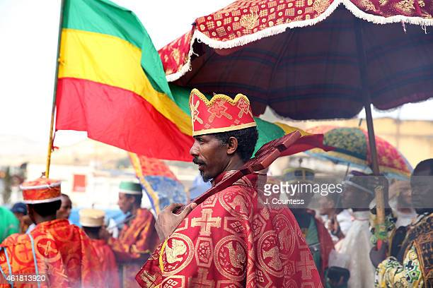An Ethiopian Orthodox Tewahedo Priest from Saint Michael Church pauses during the procession of the Tabot through the streets of the Ethiopian city...