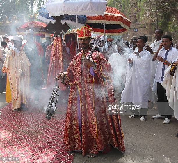 An Ethiopian Orthodox Tewahedo Priest from Saint Michael Church walks in the procession of the Tabot through the streets of the Ethiopian city of...