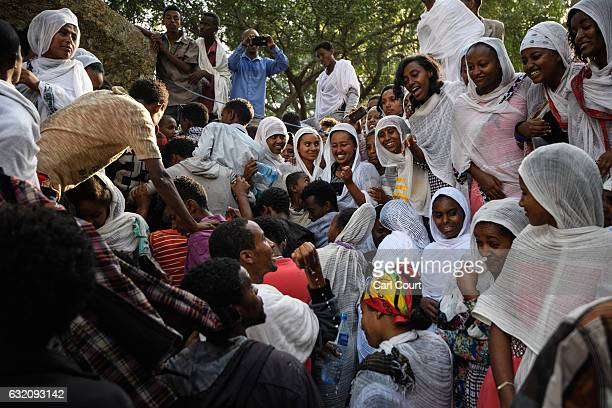 An Ethiopian Orthodox worshippers enjoy themselves at Fasilides Bath during the annual Timkat Epiphany celebration on January 19 2017 in Gondar...