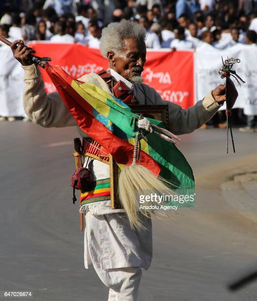 An Ethiopian veteran, wearing military uniform and medals, holds a flag during the celebration of the 121st Anniversary of Ethiopia's Battle of Adwa...