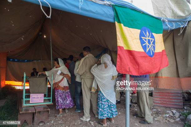 An Ethiopian woman casts her ballot on May 24 2015 in Addis Ababa during Ethiopian first general elections since the death of strongman Meles Zenawi...
