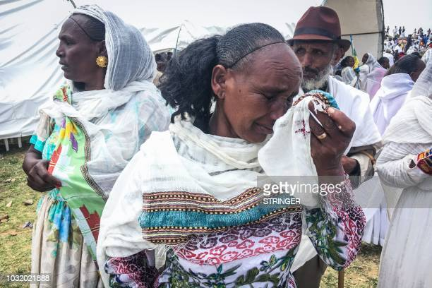 An Ethiopian woman sheds tears after meeting relatives from Eritrea during the border reopening ceremony on September 11 2018 as two land border...