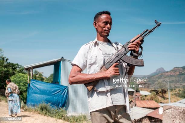 An Ethiopia's Amhara Region militia man that combat alongside federal and regional forces against northern region of Tigray poses in the town of...