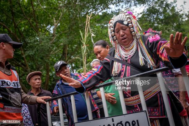 An ethnic Akha shaman perform religious rituals in order to help finding the missing children and their coach at Khun Nam Nang Non Forest Park where...