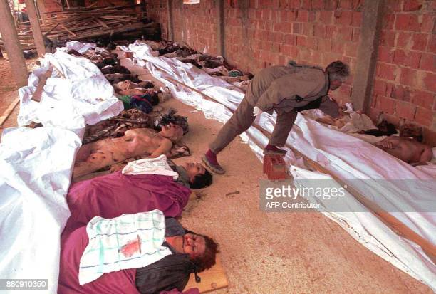 An ethnic Albanian 10 March 1998 tries to identify the bodies of his relatives killed in the village of Prekaze during last weeks fights between...