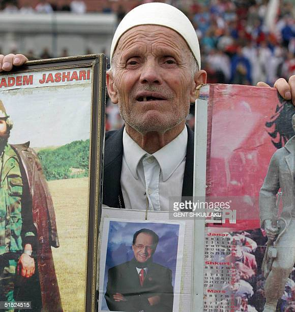 An ethnic Albanian eldery man holds a photo of the leader of the Democratic League of Kosovo Ibrahim Rugova during the last electoral rally in...