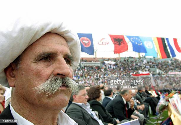 An ethnic Albanian man listens to the leader of the Democratic League of Kosovo Ibrahim Rugova during the last electoral rally in Pristina Kosovo 21...