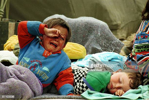An Ethnic Albanian Refugee From Kosovo Cries Out While Waiting In The Transit Camp At The Blace Border Near Skopje Macedonia Wednesday April 28 1999