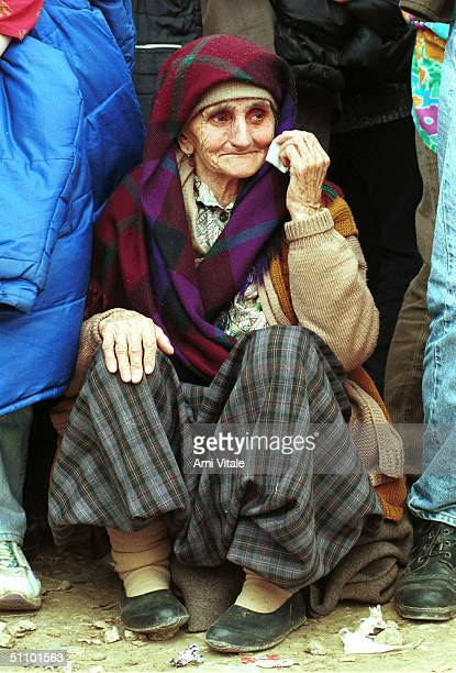 An Ethnic Albanian Refugee From Kosovo Waits To Board A Bus Leaving The Country In The Brazda Refugee Camp Nearby Skopje Macedonia April 28 1999