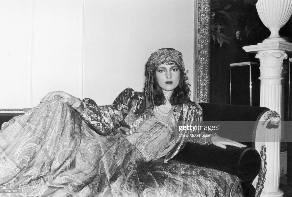 An ethnic brocade jacket and patterned dress with a turban, by designer Thea Porter, 7th December 1977.