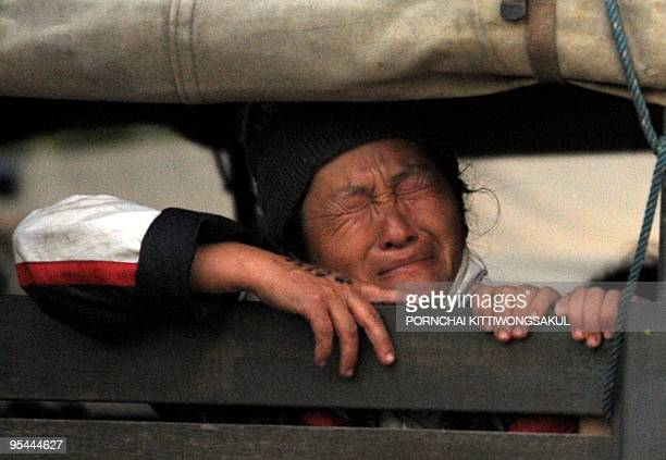 An Ethnic Hmong refugee sits inside a police truck during the operation to deport thousands of Hmong to Laos near the ethnic Hmong refugee camp in...