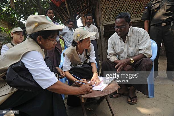 An ethnic Kaman man answers questions as census enumerators take data in the village of Bumay on the outskirts of Sittwe in the western Myanmar state...