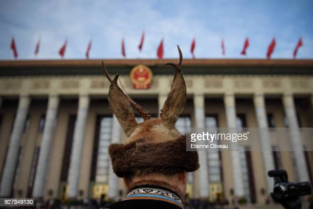 An ethnic minority delegate arrives to attend the opening session of the 13th National People's Congress at The Great Hall of People on March 5, 2018...