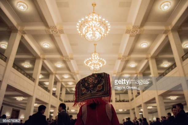 An ethnic minority delegate is seen in the Great Hall of the People before the seventh plenary session of the 13th National People's Congress on...