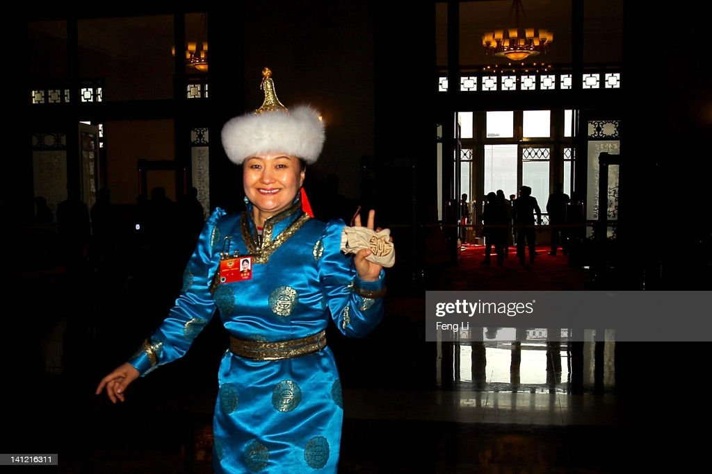 An ethnic minority delegate waves as she arrives at the Great Hall of the People before the closing ceremony of the Chinese People's Political Consultative Conference (CPPCC) on March 13, 2012 in Beijing, China. Known as 'liang hui,' or 'two organizations', it consists of meetings of China's legislature, the National People's Congress (NPC), and its advisory auxiliary, the Chinese People's Political Consultative Conference (CPPCC).