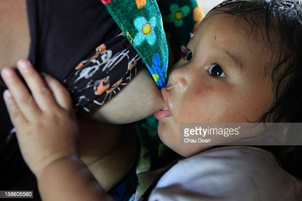 An ethnic minority H'mong boy is being breastfed by his mother in Can Ti communeThe child malnutrition rate is high in ethnic minority communities