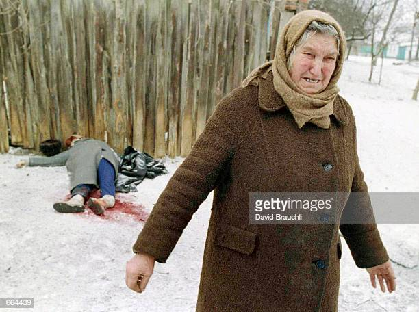 An ethnic Russian woman weeps as she walks past the bodies of a couple killed when a bomb landed between them in the embattled Chechen capital Grozny...