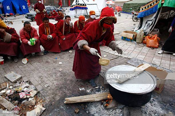 An ethnic Tibetans monk prepare for meal in the earthquake-hit town of Gyegu in Yushu County, Qinghai Province April 17, 2010. VCP