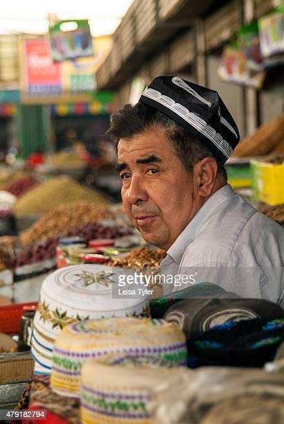 MARKET TURFAN XINJIANG CHINA An ethnic Uighur man selling doppas at Turfan market in Xinjiang Province China The Uighurs are a Turkic ethnic group...