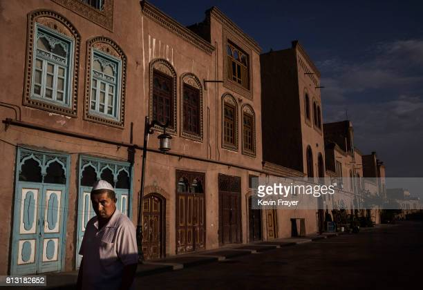 An ethnic Uyghur man walks on June 27 2017 in the old town of Kashgar in the far western Xinjiang province China Kashgar has long been considered the...