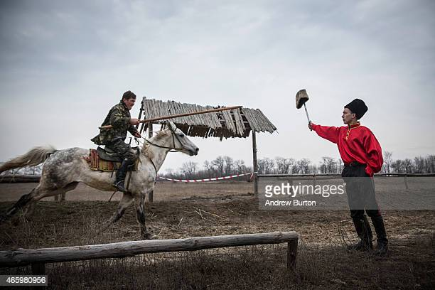 An ethnically Cossack proRussian rebel displays his horsemanship during a skills performance on March 12 2015 in Makeevka Ukraine The conflict...