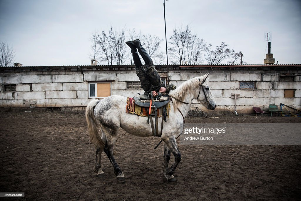 An ethnically Cossack pro-Russian rebel displays his horsemanship during a skills performance on March 12, 2015 in Makeevka, Ukraine. The conflict between Ukraine and pro-Russian rebels, which has gone on for almost a year, has left over 6,000 people dead, according to the United Nations.