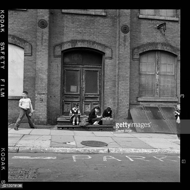 An ethnically diverse group of school children do their homework in Brooklyn Heights in March 1958 in New York City New York