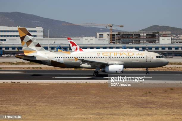 An Etihad Airways Airbus 320 leaving Athens airport