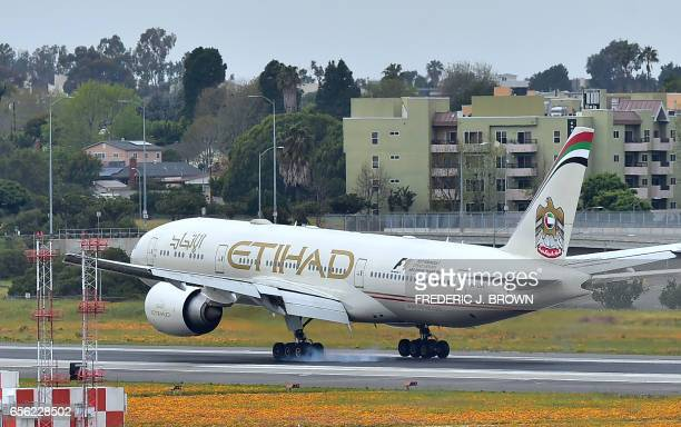 An Etihad Airways aircraft flight 171 from Abu Dhabi comes in for a landing at Los Angeles International Airport on March 21 2017 in Los Angeles...