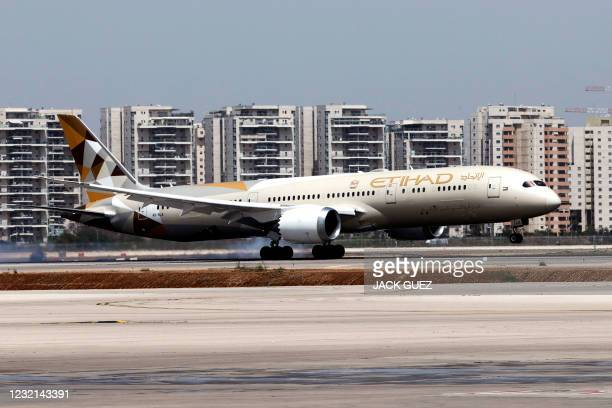 """An Etihad Airways Boeing 787-9 """"Dreamliner"""" aircraft breaks during landing upon arrival from the United Arab Emirates at Israel's Ben Gurion Airport..."""