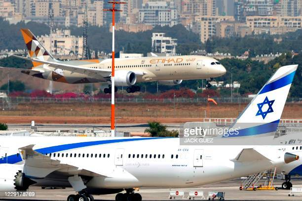 "An Etihad Airways Boeing 787-9 ""Dreamliner"" aircraft carrying a delegation from the United Arab Emirates on a first official visit, lands at Israel's..."
