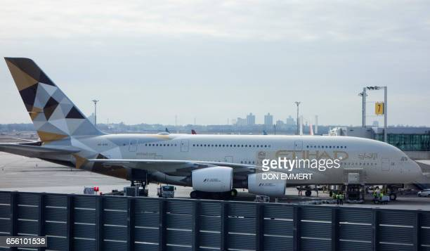 An Etihad Airways jet can be seen parked at the terminal on March 21 2017 at John F Kennedy International Airport in New York Passengers traveling to...